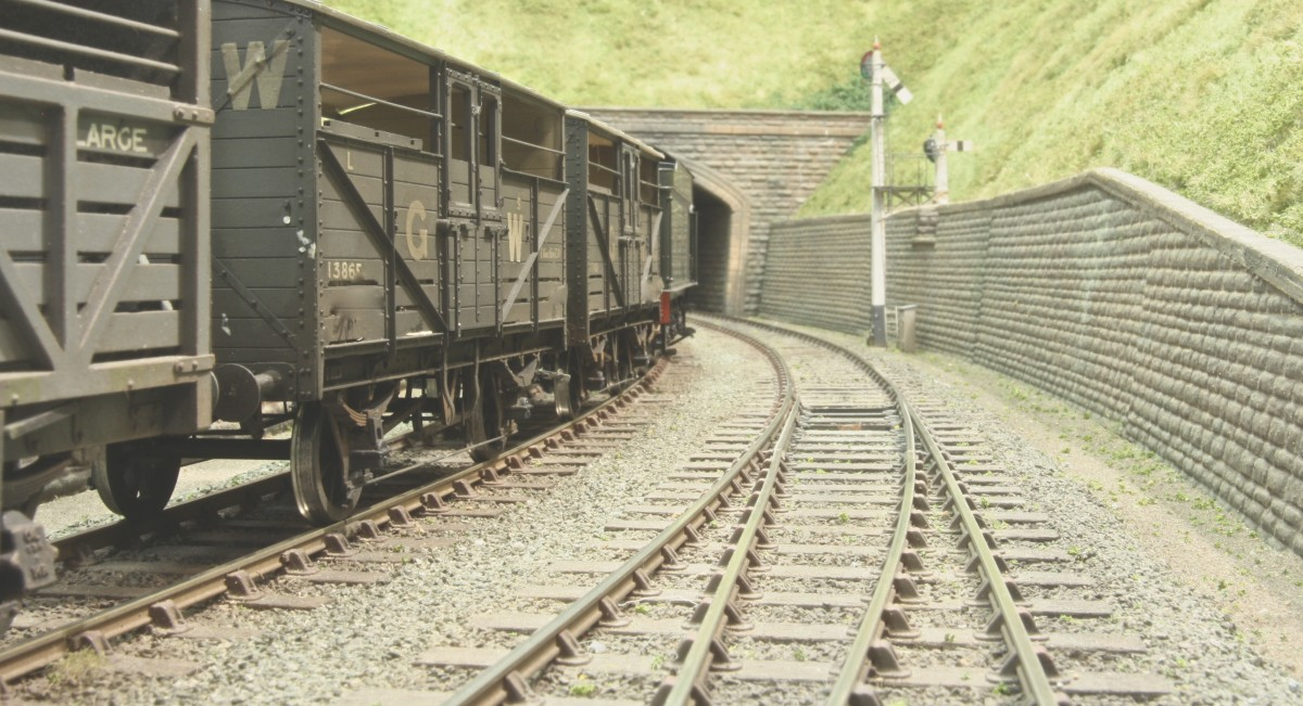 We haven't even started on the goods vehicles yet, and there is a wealth of great building work and hand lettered vehicles to document. This picture shows the hand laid C&L trackwork on wooden sleepers.