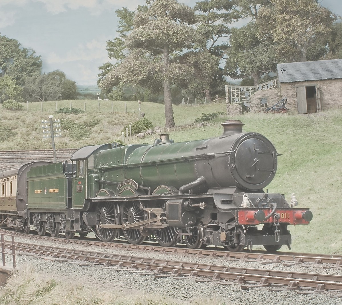 This was the cover photo, but it shows a little more background here. No 6011 King Edward 1 heads east with nine on.