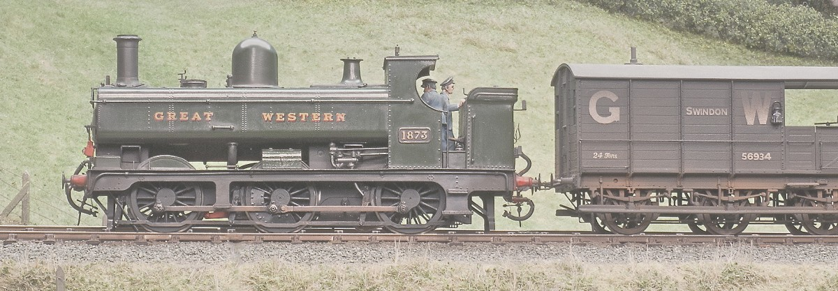 Part of the heading picture from the January Railway Modeller feature. An 1890 Dean Pannier tank No 1873 and a six wheeled brake van head west on the down main.
