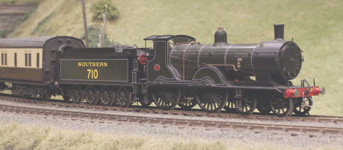 A Drummond T9 4-4-0 heads a Great Western corridor rake along the up main. This ex L.S.W.R greyhound was built by Dubs & Co in summer 1899.