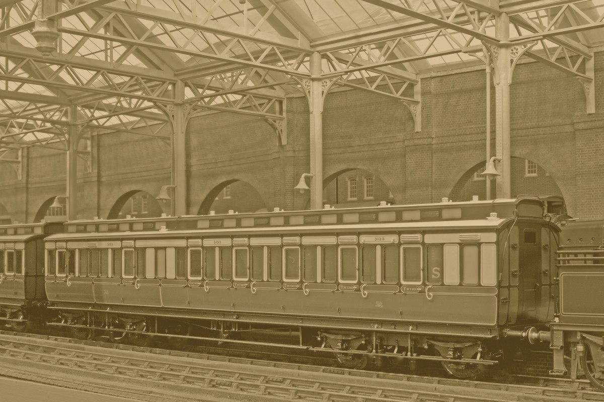 One of Lee's new clerestoried Corridor Third carriages, No 3133 at rest. Built to Diagram C17 in April 1898, it is seen here as new in the early fully lined livery, with full underframe and roof detail. The compartment interior partitions have luggage racks, paintings, mirrors and the upholstery is also buttoned. Auto couplers can be substituted in place of the standard screw couplers supplied, which attach to the tender of the train's locomotive (Just in shot to the picture right).