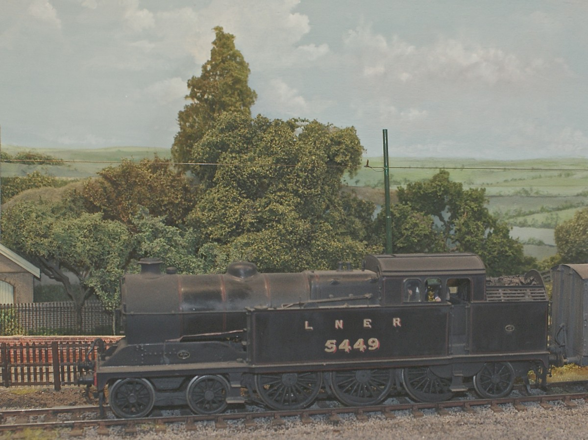 An ex G.C.R. Robinson A5 class 4-6-2T arrives at Westcott with a van train.