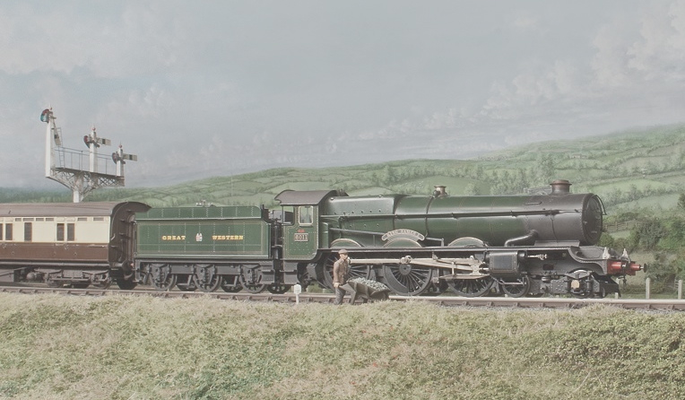 No 6011, 'King James 1' in the original 1928 condition, runs along the embankment with an up express.