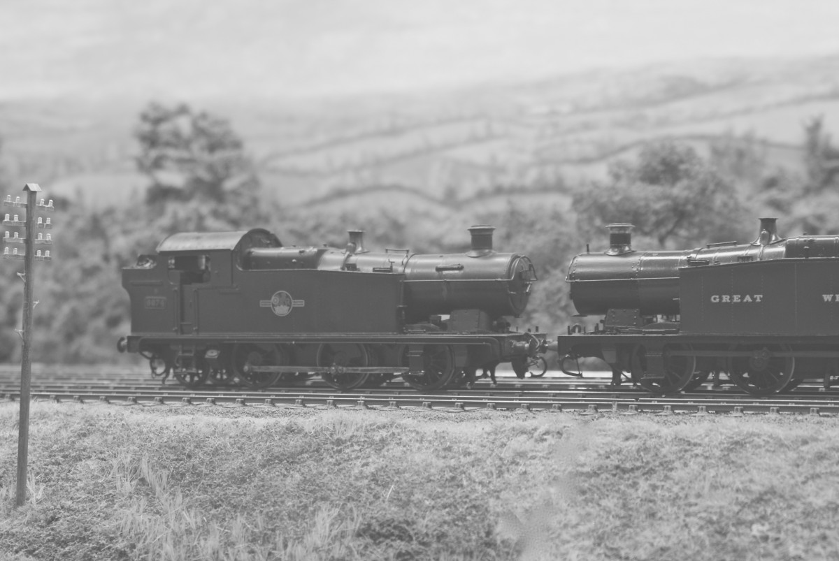 A pair of Welsh valleys 0-6-2Ts, as Nigel's pilots Dave Thomas's G.W.R. example bunker first. Re-starting from this pause, the train engine slipped intermittently until the train gathered speed again.