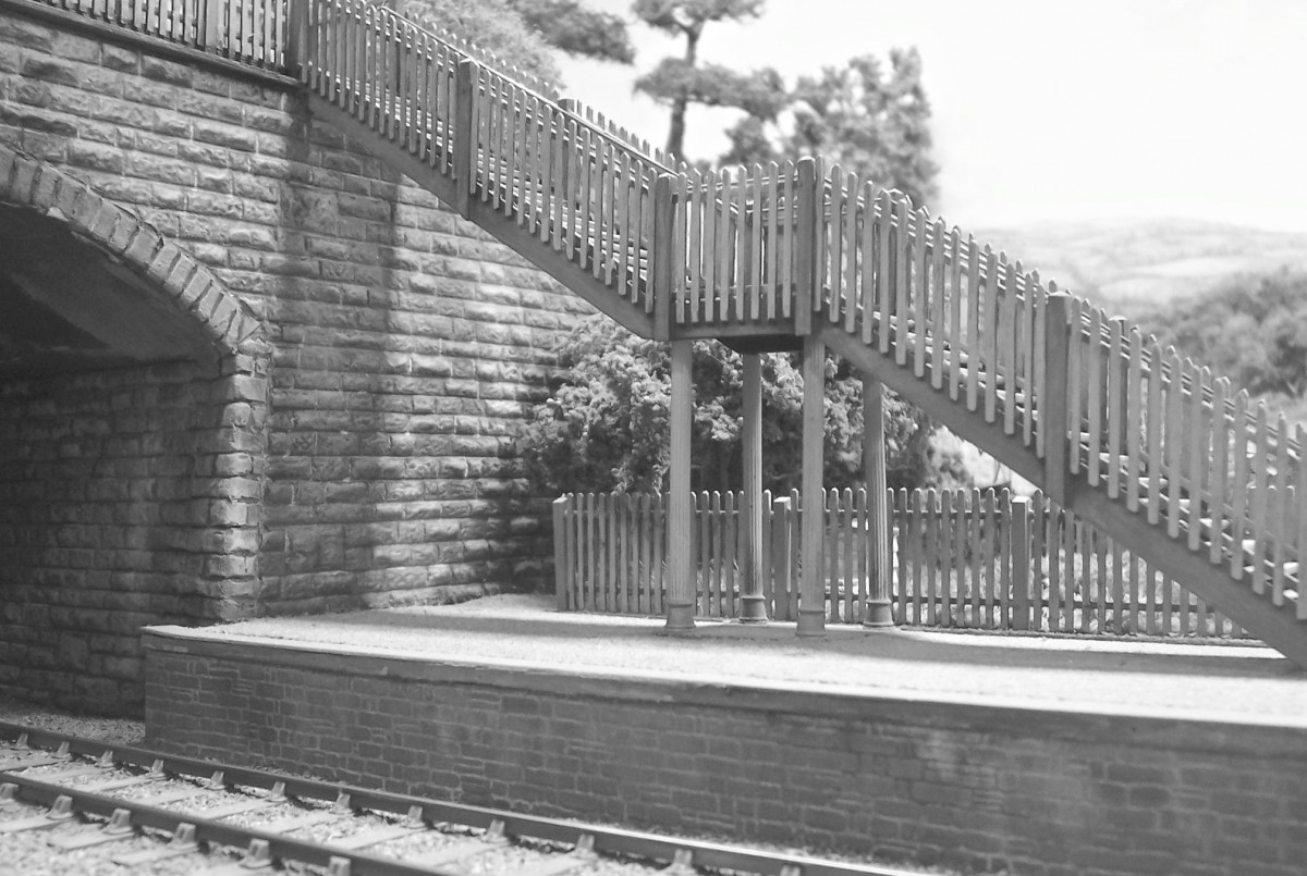 Bucks Hill usually feels busy, but in this study, there's nobody about, just a deserted wooden platform footbridge.