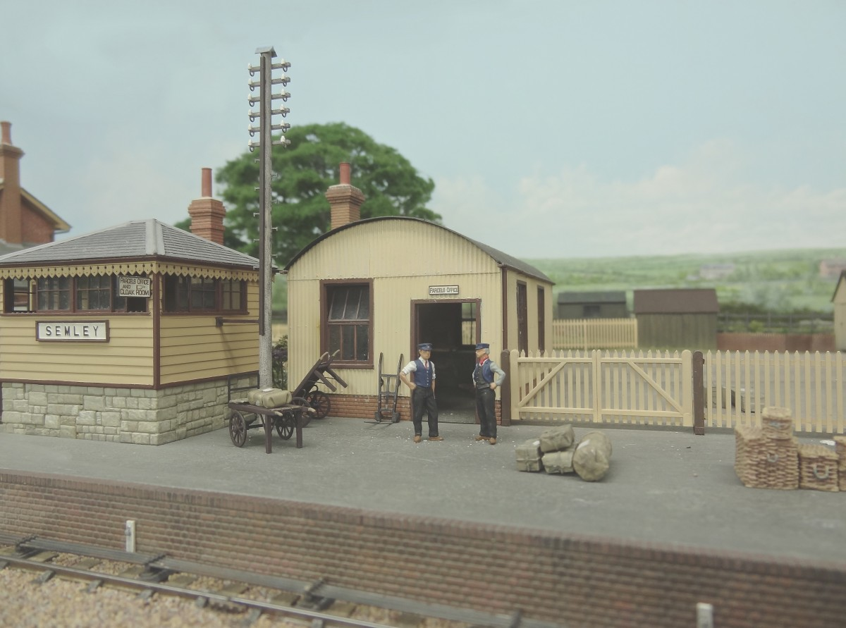 Some of the work at Missenden Abbey will be with 2D backscene rear panels, and this one appears behind Semley's small stone and timber L.S.W.R. signalbox and corrugated parcels office. The fabulous P4 layout now has it's most recent detail work in position. and the telegraph pole, station staff, barrows and parcels complete the scene to the very highest standard of presentation. Photo courtesy of Martin Finney